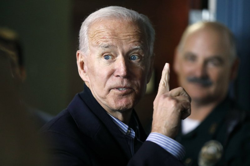 In this May 13, 2019, photo, former vice president and Democratic presidential candidate Joe Biden interacts with a supporter during a campaign stop at the Community Oven restaurant in Hampton, N.H.  North Korea has labeled Biden a