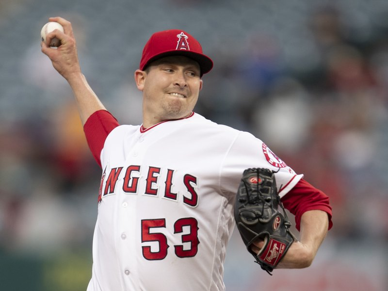 Los Angeles Angels starting pitcher Trevor Cahill delivers a pitch during the first inning of a baseball game against the Minnesota Twins in Anaheim, Calif., Tuesday, May 21, 2019. (AP Photo/Kyusung Gong)