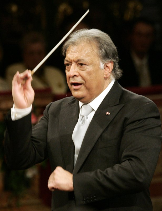 "FILE- In this Jan. 1, 2007 file photo, Maestro Zubin Mehta conducts the Vienna Philharmonic Orchestra during the traditional New Year's concert at Vienna's Musikverein. When Mehta joined the Israel Philharmonic Orchestra in 1969, Lahav Shani wasn't even alive. Now, at the age of 30, the Israeli wunderkind is poised to succeed his mentor at the helm of the acclaimed symphony. Mehta, 83, is set to step down late this year after leading the orchestra for half a century and serving as its ""music director for life"" since 1981. (AP Photo/Hans Punz, File)"