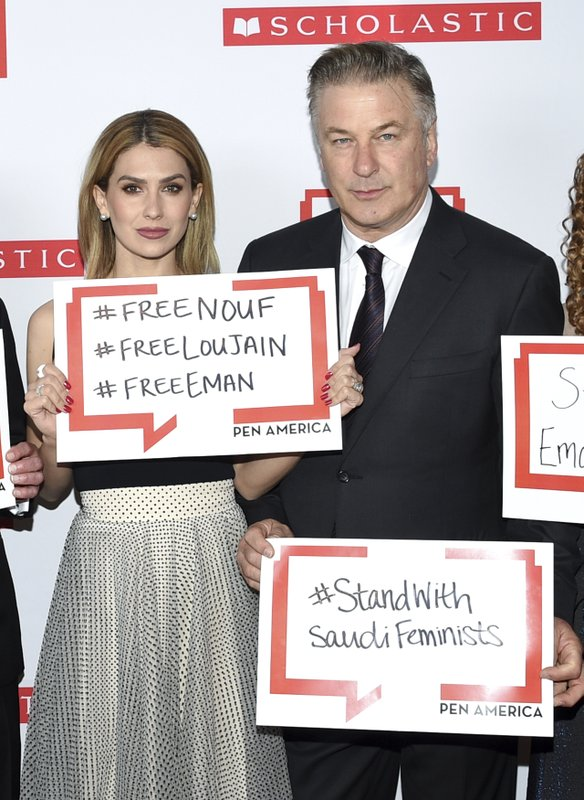 Actor Alec Baldwin and wife Hilaria Baldwin pose holding signs in support of jailed Saudi women's rights activists Nouf Abdulaziz, Loujain Al-Hathloul and Eman Al-Nafjan at the 2019 PEN America Literary Gala at the American Museum of Natural History on Tuesday, May 21, 2019, in New York. (Photo by Evan Agostini/Invision/AP)