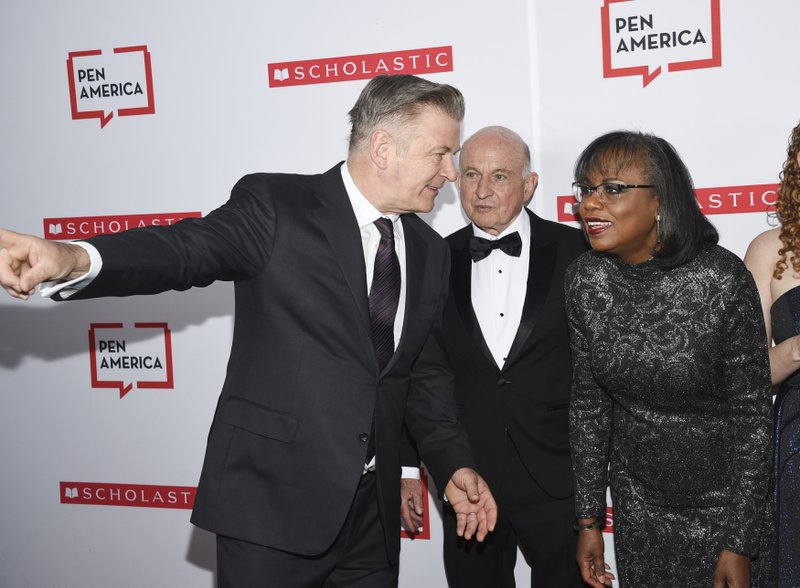 Actor Alec Baldwin, left, chats with PEN courage award recipient Anita Hill at the 2019 PEN America Literary Gala at the American Museum of Natural History on Tuesday, May 21, 2019, in New York. (Photo by Evan Agostini/Invision/AP)