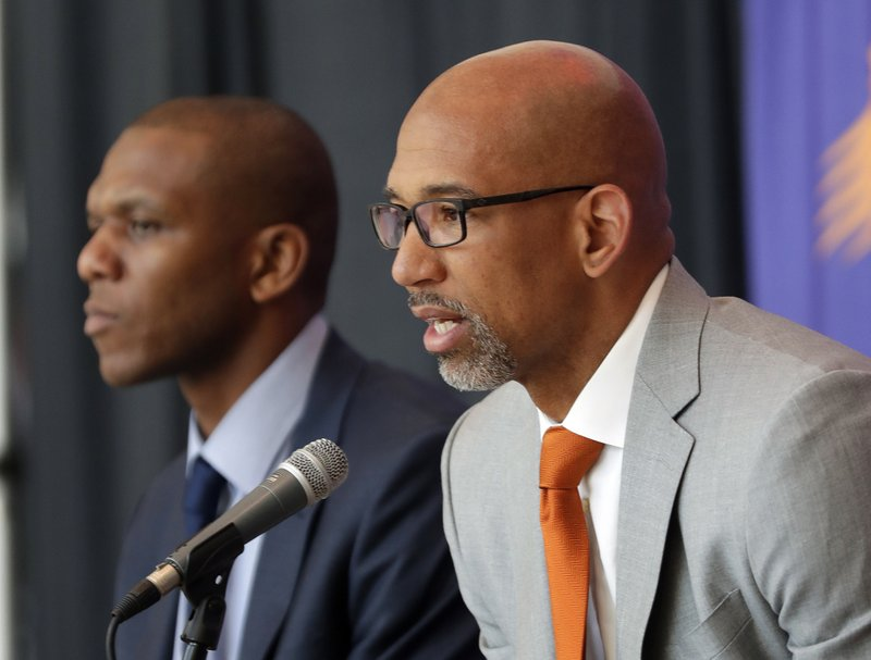 Phoenix Suns new NBA basketball head coach Monty Williams, right, speaks as general manger James Jones listens during a news conference, Tuesday, May 21, 2019, in Phoenix. (AP Photo/Matt York)