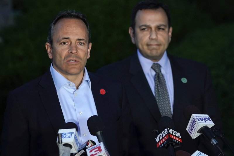 Kentucky Gov. Matt Bevin, left, and Kentucky Sen. Ralph Alvarado, the Republican nominee for lieutenant governor, speak to the media after winning the Republican gubernatorial primary, in Frankfort, Ky., Tuesday, May 21, 2019. (AP Photo/Bryan Woolston)
