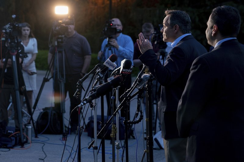 Kentucky Gov. Matt Bevin addresses the media after winning the Republican gubernatorial primary, in Frankfort, Ky., Tuesday, May 21, 2019. At right is Kentucky Sen. Ralph Alvarado, the Republican nominee for lieutenant governor. (AP Photo/Bryan Woolston)