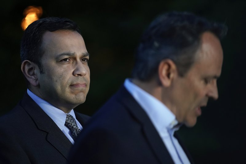 Kentucky Sen. Ralph Alvarado, left, the Republican nominee for lieutenant governor, stands with Kentucky Gov. Matt Bevin as the governor speaks to the media after winning the Republican gubernatorial primary, in Frankfort, Ky., Tuesday, May 21, 2019. (AP Photo/Bryan Woolston)