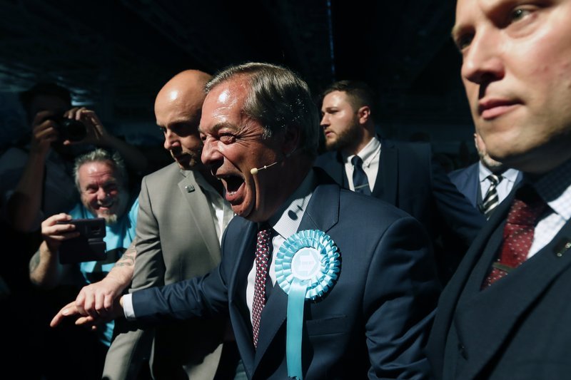FILE - In this Tuesday, May 21, 2019 file photo, Brexit Party leader Nigel Farage, center, shakes hands with his supporters during a Brexit Party rally in London. The European Parliament elections have never been so hotly anticipated or contested, with many predicting that this year's ballot will mark a coming-of-age moment for the euroskeptic far-right movement. The elections start Thursday May 23, 2019 and run through Sunday May 26 and are taking place in all of the European Union's 28 nations. (AP Photo/Frank Augstein, File)