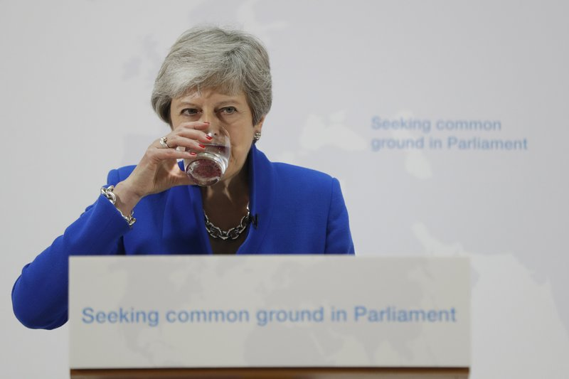 Britain's Prime Minister Theresa May drinks water during a speech in London, Tuesday, May 21, 2019. The British government is discussing how to tweak its proposed European Union divorce terms in a last-ditch attempt to get Parliament's backing for Prime Minister Theresa May's deal with the bloc. (AP Photo/Kirsty Wigglesworth, pool)