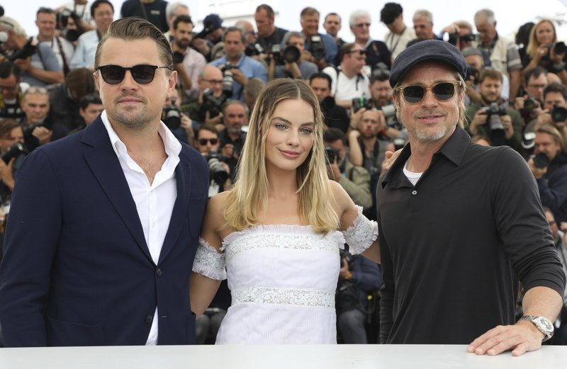 Actors Leonardo DiCaprio, from left, Margot Robbie and Brad Pitt pose for photographers at the photo call for the film 'Once Upon a Time in Hollywood' at the 72nd international film festival, Cannes, southern France, Wednesday, May 22, 2019. (Photo by Vianney Le Caer/Invision/AP)