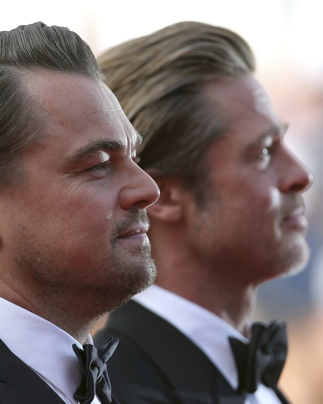 Actors Leonardo DiCaprio, left, and Brad Pitt pose for photographers upon arrival at the premiere of the film 'Once Upon a Time in Hollywood' at the 72nd international film festival, Cannes, southern France, Tuesday, May 21, 2019. (AP Photo/Petros Giannakouris)