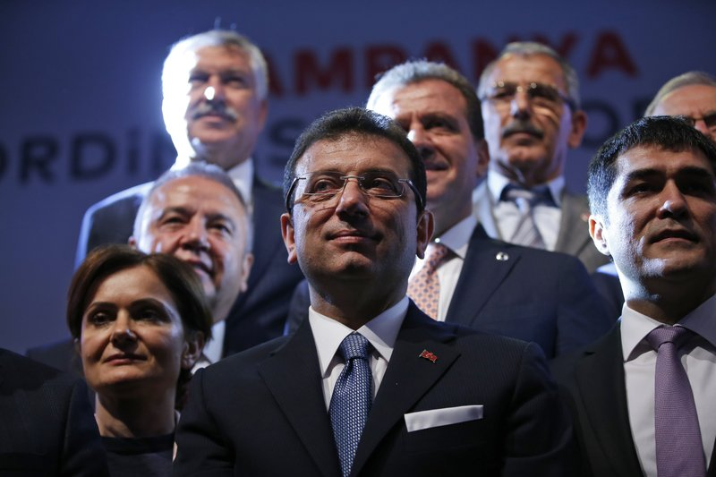 Ekrem Imamoglu, centre, Turkey's opposition, Republican People's Party's (CHP) mayoral candidate for Istanbul poses for pictures with party officials, following his speech at the launch of his campaign for the June 23 re-run elections, in Istanbul, Wednesday, May 22, 2019. Imamoglu, promising he would win back the seat after Turkey's electoral board ruled to void the local polls earlier this month, is running a positive messaging campaign under the motto