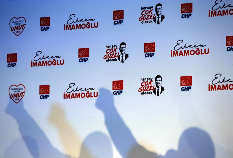 The shadow of Ekrem Imamoglu, Turkey's opposition, Republican People's Party's (CHP) mayoral candidate for Istanbul is cast on the wall as he delivers a speech at the launch of his campaign for the June 23 re-run elections, in Istanbul, Wednesday, May 22, 2019. Imamoglu, promising he would win back the seat after Turkey's electoral board ruled to void the local polls earlier this month, is running a positive messaging campaign under the motto