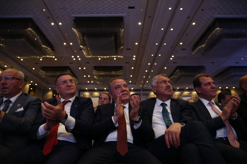 Supporters of Ekrem Imamoglu, Turkey's secular opposition, Republican People's Party's (CHP) mayoral candidate for Istanbul listen to his speech at the launch of his campaign for the June 23 re-run elections, in Istanbul, Wednesday, May 22, 2019. Imamoglu, promising he would win back the seat after Turkey's electoral board ruled to void the local polls earlier this month, is running a positive messaging campaign under the motto
