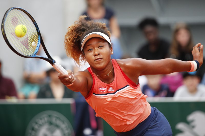 FILE - In this May 30, 2018, file photo, Japan's Naomi Osaka returns a shot against Kazakhstan's Zarina Diyas during their second round match of the French Open tennis tournament at the Roland Garros stadium in Paris, France. (AP Photo/Christophe Ena, File)