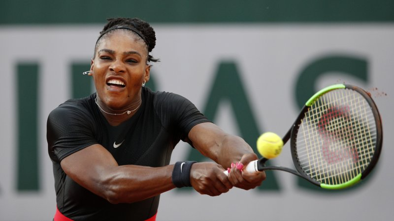 FILE - In this June 2, 2018, file photo, Serena Williams of the United States, returns a shot against Germany's Julia Georges during their third round match at the French Open tennis tournament at the Roland Garros stadium in Paris, France. (AP Photo/Christophe Ena, File)