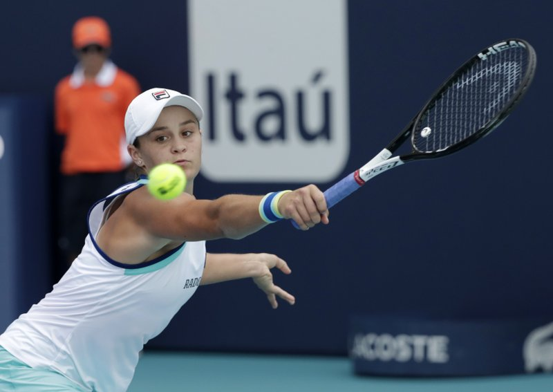 FILE - In this March 30, 2019, file photo, Ashleigh Barty, of Australia, returns to Karolina Pliskova, of the Czech Republic, during the women's singles final of the Miami Open tennis tournament in Miami Gardens, Fla. (AP Photo/Lynne Sladky, File)