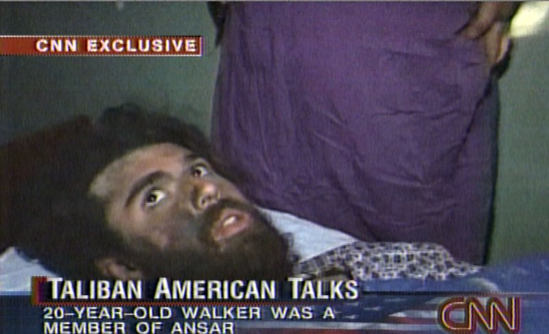 FILE - In this file image taken from video broadcast Dec. 19, 2001,  John Walker Lindh is seen during an interview soon after his capture. According to CNN, the interview took place Dec. 2, 2001. Lindh, the young Californian who became known as the American Taliban after he was captured by U.S. forces in the invasion of Afghanistan in late 2001, is set to go free Thursday, May 23, 2019, after nearly two decades in prison. (CNN via AP, File)
