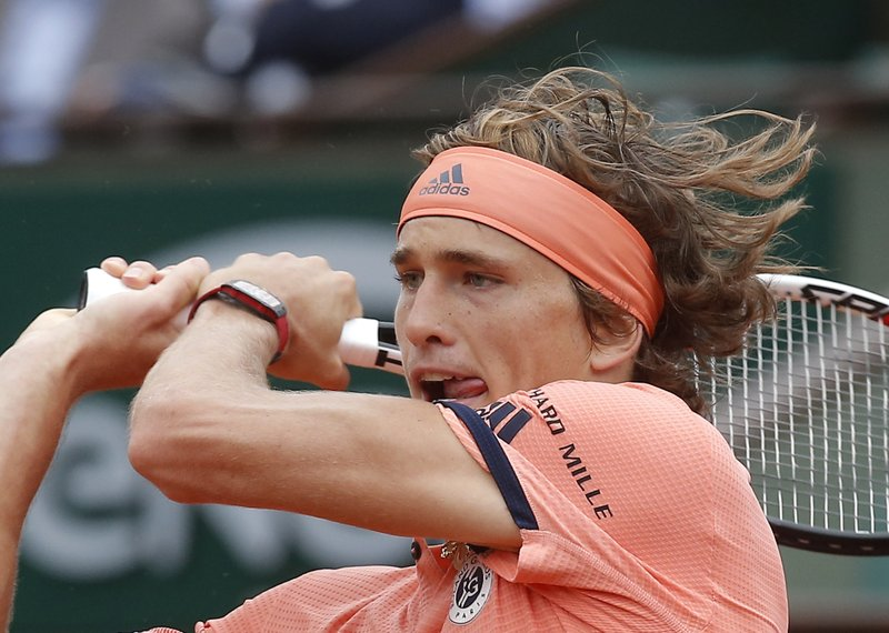FILE - In this June 5, 2018, file photo, Germany's Alexander Zverev returns the ball to Austria's Dominic Thiem during their quarterfinal match of the French Open tennis tournament at the Roland Garros stadium in Paris. (AP Photo/Michel Euler, File)