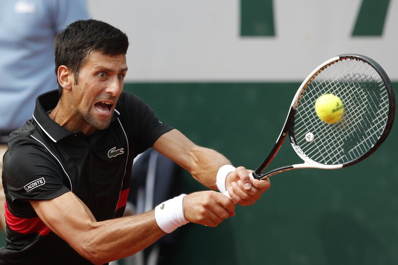 FILE - In this June 5, 2018, file photo, Serbia's Novak Djokovic returns a shot against Italy's Marco Cecchinato during their quarterfinal match of the French Open tennis tournament at the Roland Garros stadium in Paris, France. (AP Photo/Christophe Ena, File)