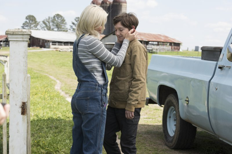 This image released by Sony Pictures shows Elizabeth Banks, left, and  Jackson A. Dunn in a scene from Screen Gems'
