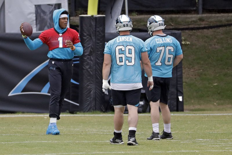 Carolina Panthers' Cam Newton works out during the NFL football team's practice in Charlotte, N.C., Wednesday, May 22, 2019. (AP Photo/Chuck Burton)