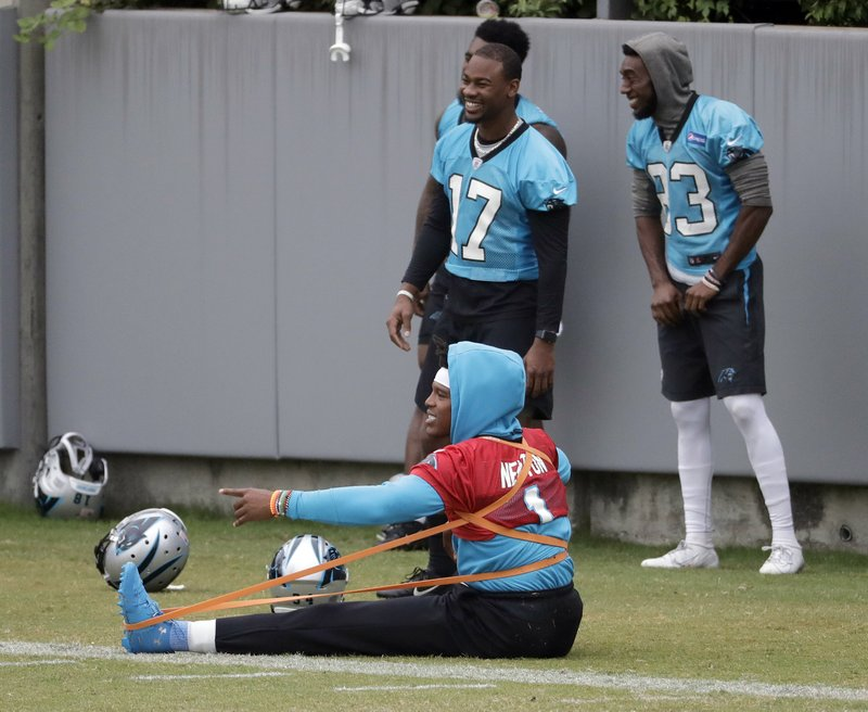 Carolina Panthers' Cam Newton stretches during the NFL football team's practice in Charlotte, N.C., Wednesday, May 22, 2019. (AP Photo/Chuck Burton)