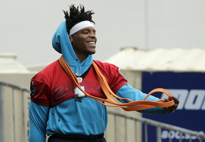 Carolina Panthers' Cam Newton arrives for the NFL football team's practice in Charlotte, N.C., Wednesday, May 22, 2019. (AP Photo/Chuck Burton)