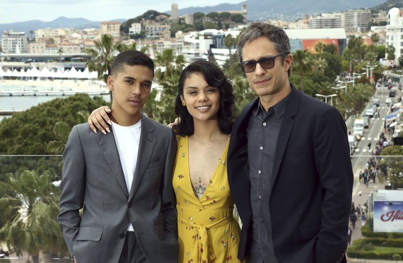 Actors Benny Emmanuel, from left, Leidi Gutierrez and director Gael Garcia Bernal pose for portrait photographs for the film 'Chicuarotes' at the 72nd international film festival, Cannes, southern France, Tuesday, May 21, 2019. (Photo by Joel C Ryan/Invision/AP)