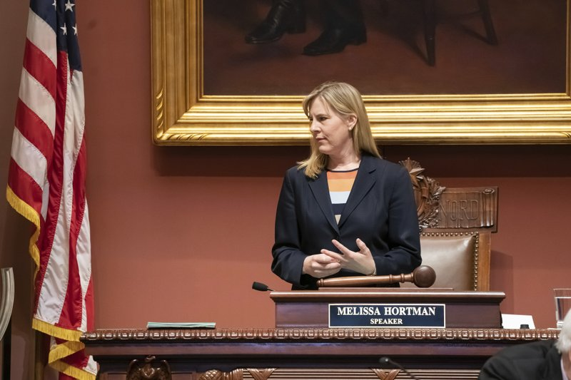 House Speaker Melissa Hortman looks onto the House floor Monday, May 20, 2019 in St. Paul, Minn. Minnesota Gov. Tim Walz and top legislative leaders have reached a bipartisan budget agreement that drops the governor's proposed gasoline tax increase but gives middle-class Minnesotans an income tax cut and preserves most of an expiring tax that funds health care. (Glen Stubbe/Star Tribune via AP)