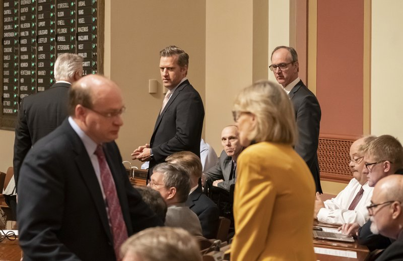 Republican House Minority Leader Kurt Daudt comes onto the House floor Monday,  May 20, 2019 to talk with other Republican legislators and House Speaker Melissa Hortman on the last regular day of the legislative session as they plot out what comes next with a special session certain.   (Glen Stubbe/Star Tribune via AP)