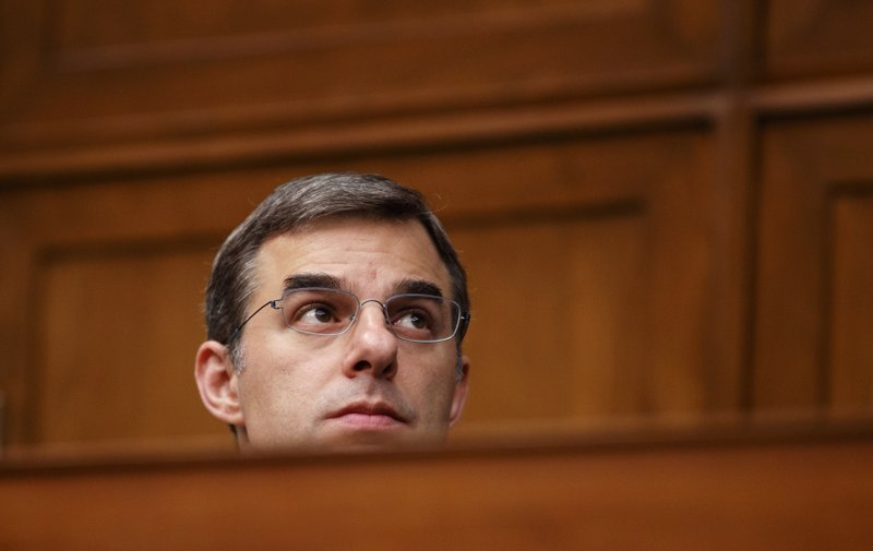 House Oversight and Reform National Security subcommittee member Rep. Justin Amash, R-Mich., watches from the dais on Capitol Hill in Washington, Wednesday, May 22, 2019, during the House Oversight and Reform National Security subcommittee hearing on
