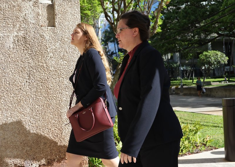 Former Honolulu deputy city prosecutor Katherine Kealoha, right, walks into federal court in Honolulu on Wednesday, May 22, 2019. A trial for what has been described as the biggest corruption case in Hawaii history began Wednesday for Kealoha and her husband, former police chief Louis Kealoha. The two are accused of conspiring to frame Katherine Kealoha's uncle for a crime he did not commit. The Kealoha's were indicted on charges including conspiracy and obstruction. Federal authorities began investigating the two in 2015 and both stepped down from their jobs as the probe deepened. (AP Photo/Caleb Jones)