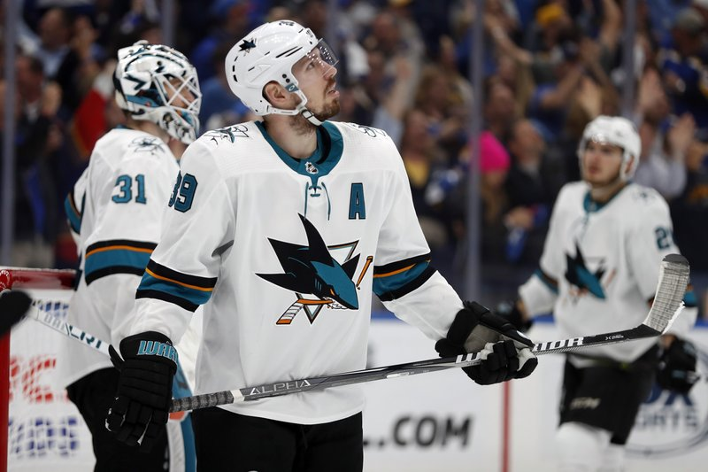 San Jose Sharks center Logan Couture (39) looks up at the scoreboard after the St. Louis Blues scored a goal during the third period in Game 6 of the NHL hockey Stanley Cup Western Conference final series Tuesday, May 21, 2019, in St. Louis. The Blues won 5-1 to win the series 4-2. (AP Photo/Jeff Roberson)