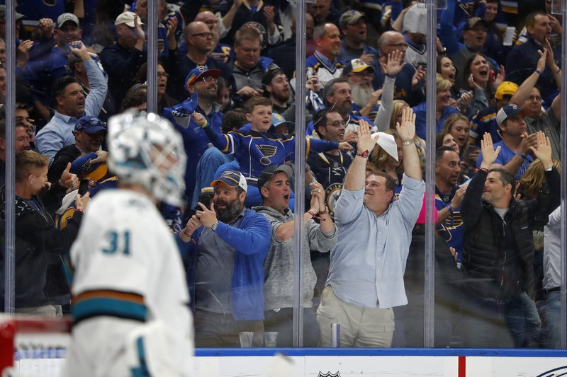 St. Louis Blues fans cheer after the Blues scored a goal against San Jose Sharks goaltender Martin Jones (31) during the third period in Game 6 of the NHL hockey Stanley Cup Western Conference final series Tuesday, May 21, 2019, in St. Louis. The Blues won 5-1 to win the series 4-2. (AP Photo/Jeff Roberson)
