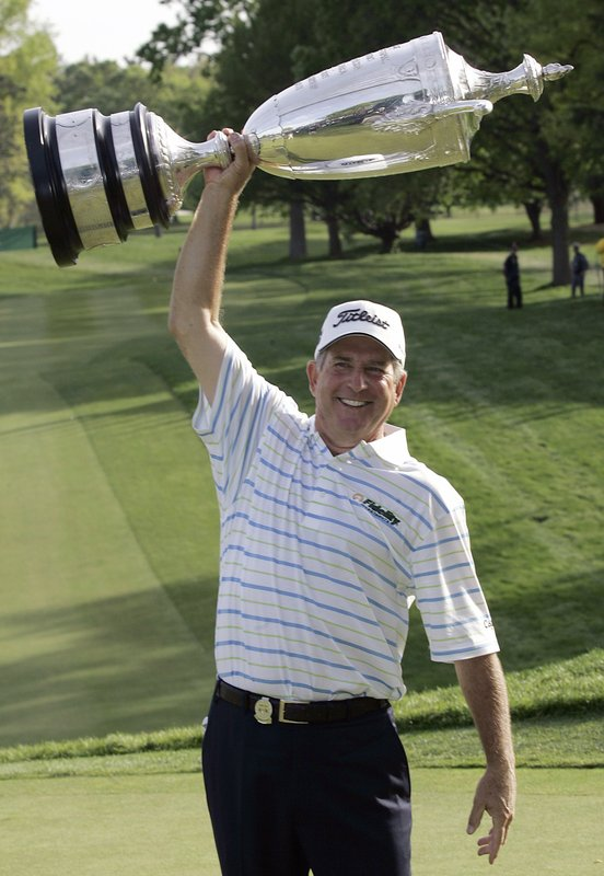 FILE - In this May 25, 2008, file photo, Jay Haas holds up the trophy and celebrates winning the Senior PGA Championship golf tournament at Oak Hill Country Club in Rochester, N.Y. It didn't take long for Haas to be reminded of how gusting winds can play havoc on those making their way around Oak Hill Country Club's East Course.
