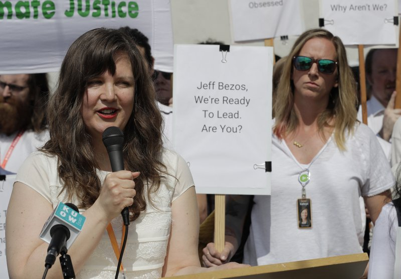 Emily Cunningham, left, who works as a user experience designer at Amazon.com, speaks as Kathryn Dellinger, right, who also works for Amazon, looks on, during a news conference following Amazon's annual shareholders meeting, Wednesday, May 22, 2019, in Seattle. Both women are part of the group