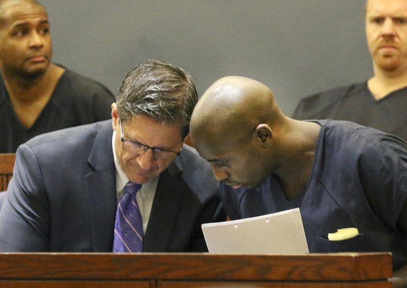 Former NFL player Cierre Wood, right, who along with his girlfriend, is charged with first-degree murder in the death of her 5-year-old daughter, La'Rayah Patra Nicole Lamont Davis, appears in court with his attorney Thomas Ericsson at the Regional Justice Center on Wednesday, May 22, 2019, in Las Vegas. (Bizuayehu Tesfaye/Las Vegas Review-Journal via AP)