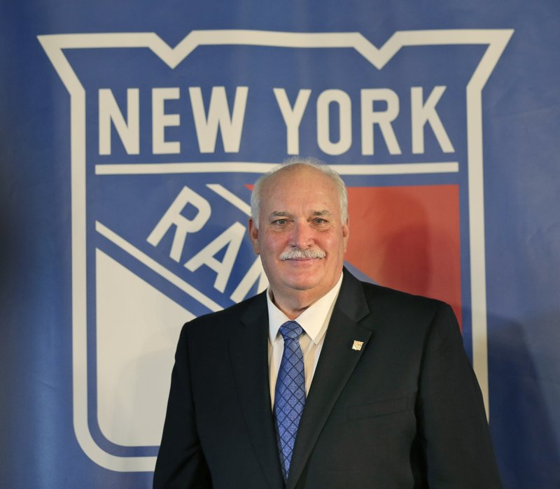 John Davidson, the new president of the New York Rangers, poses for a picture during a news conference in New York, Wednesday, May 22, 2019. Davidson was hired as team president Friday hours after leaving his post with the Columbus Blue Jackets. He returns to New York where he spent parts of eight seasons as a Rangers goaltender and was a TV analyst for almost a decade. (AP Photo/Seth Wenig)
