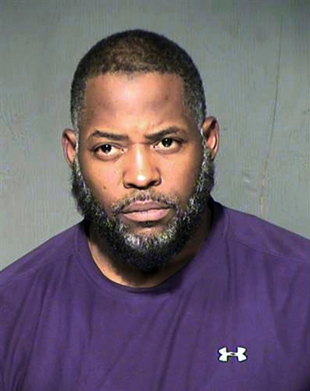 FILE - This undated file photo provided by the Maricopa County Sheriff's Department shows Abdul Malik Abdul Kareem. Kareem was convicted of providing guns to the two Islamic State followers, Elton Simpson and Nadir Soofi, who attacked a Prophet Muhammad cartoon contest nearly four years ago in Garland, Texas. He cites an undercover FBI agent's presence outside the event in seeking a new trial. (Maricopa County Sheriff's Department via AP, File)