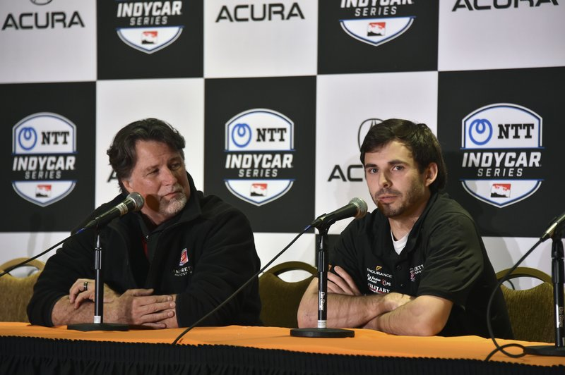 In this photo provided by IMS Photo, Michael Andretti, left, and Jarrett Andretti during a news conference for the Freedom 100 Indy Lights auto race, in Long Beach, Calif., Friday, April 12, 2019. Jarrett Andretti will become the seventh Andretti to race at Indianapolis Motor Speedway, and he'll be doing it 50 years after his great-uncle Mario captured the family's only victory in the Indy 500. (John Cote/IMS Photo via AP)