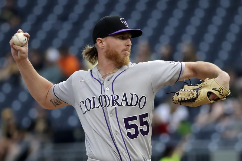 Colorado Rockies starting pitcher Jon Gray delivers in the first inning of the team's baseball game against the Pittsburgh Pirates in Pittsburgh, Wednesday, May 22, 2019. (AP Photo/Gene J. Puskar)