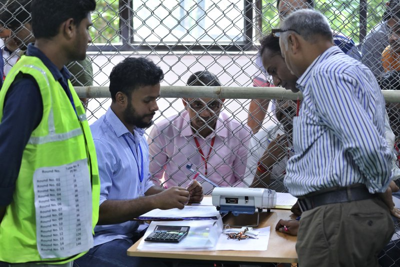 Election officials begin counting votes of India's massive general elections, in New Delhi, India, Thursday, May 23, 2019. The count is expected to conclude by the evening, with strong trends visible by midday. (AP Photo/Manish Swarup)