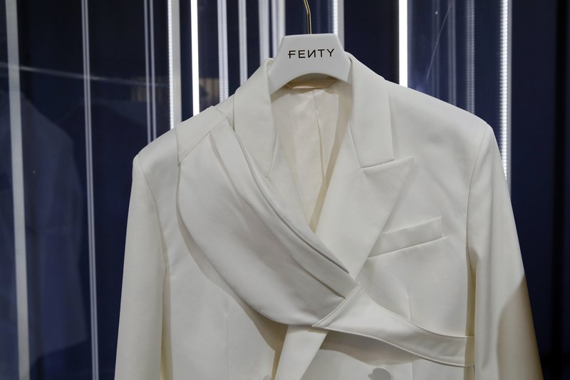 A design by Rihanna is unveiled as her first fashion designs for Fenty at a pop-up store in Paris, France, Wednesday, May 22, 2019.  Singer Rihanna is the first black woman in history to head up a major Parisian luxury house, and the collection, named after the singer turned designer's last name, comprises of ready-to-wear, footwear, accessories, and eyewear and is available for sale Paris' Le Marais area from Friday and will debut online May 29. (AP Photo/Francois Mori)