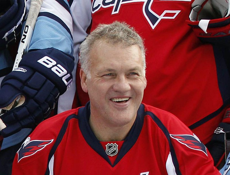 """FILE - In this Dec. 31, 2010, file photo, former Washington Capitals hockey player Dennis Maruk smiles for a photo after an exhibition game in Pittsburgh. Three decades removed from a 922-game NHL career, he's 63 and knows all about his counterparts who died between age 60 and 65 _ if not younger. """"Everything's going good,"""" Maruk said. """"I worry about myself in the future. What am I going to be like in two years down the road?""""  Maruk, who joined the concussion lawsuit, doesn't worry about it every day but hears about former players developing dementia and wonders about the day when his brain might desert him. (AP Photo/Gene J. Puskar, File)"""