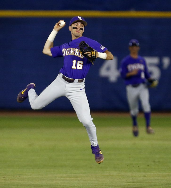 LSU shortstop Brandt Broussard throws to first but not in time for to get Mississippi State's Jake Mangum out during the first inning of a Southeastern Conference tournament NCAA college baseball game Wednesday, May 22, 2019, in Hoover, Ala. (AP Photo/Butch Dill)