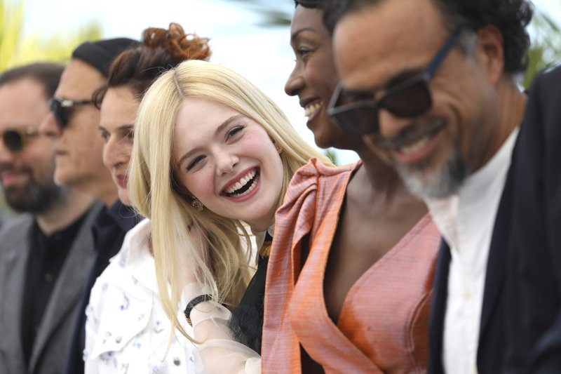 Elle Fanning, center, appears with fellow jury members at the photo call during the Cannes Film Festival on May 14. (Photo by Vianney Le Caer/Invision/AP)