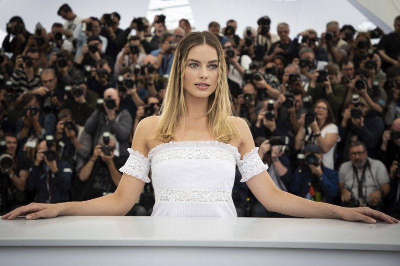 Australian actress Margot Robbie poses at the photo call for