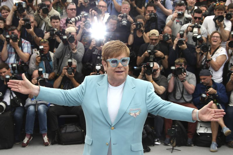 Singer Elton John poses at the photo call for