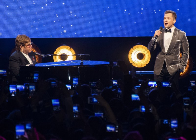 Elton John and Taron Egerton perform at the party for the film '