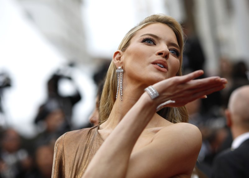 Model Martha Hunt blows a kiss at the premiere of