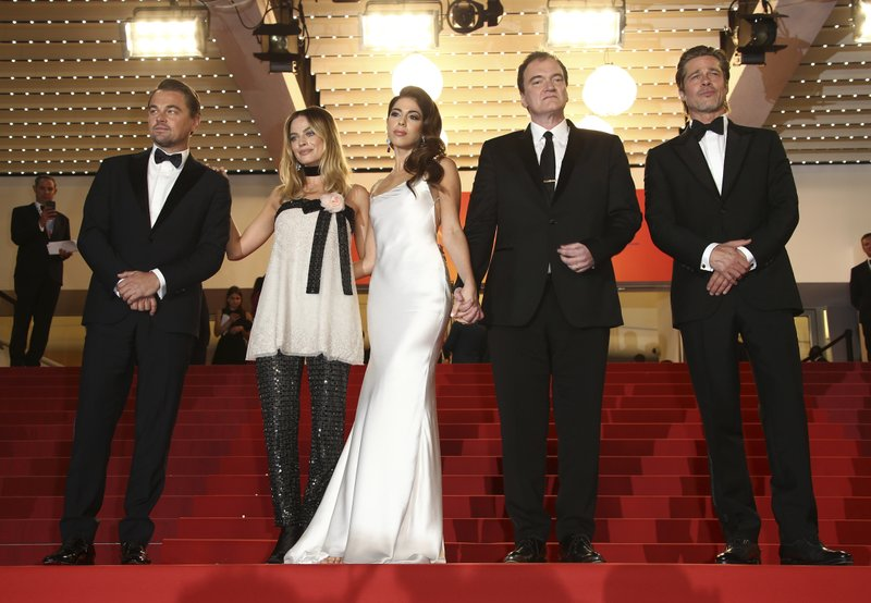 Actor Brad Pitt, from right, director Quentin Tarantino, his wife Daniela Pick, and actors Margot Robbie and Leonardo DiCaprio appear at the premiere of